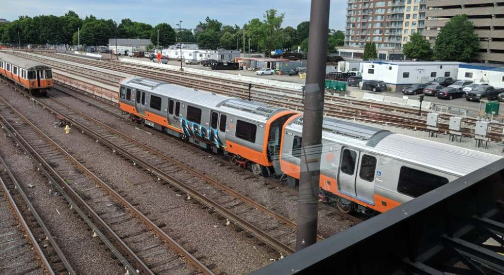 New Orange Line Train Graffitied..jpg